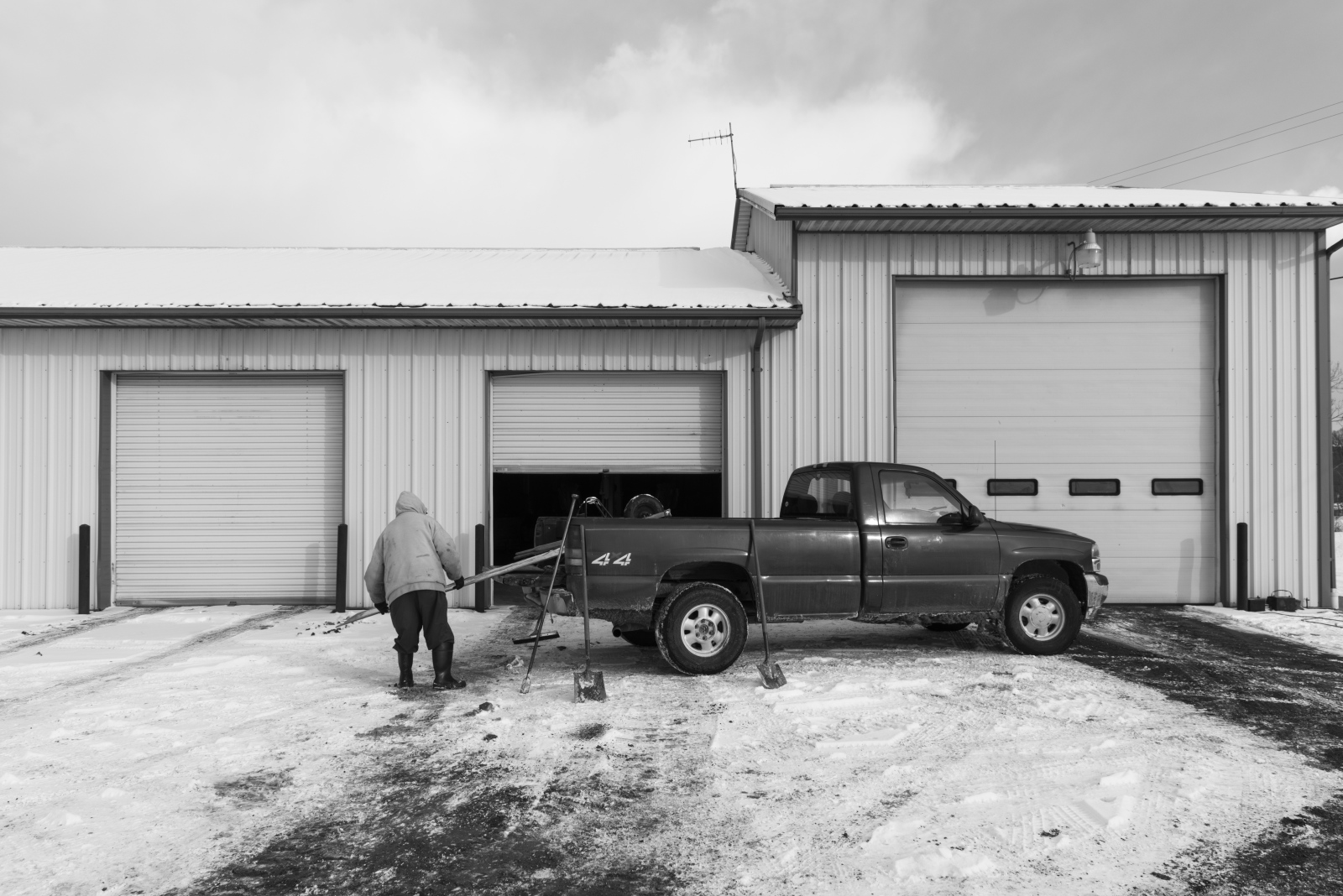Dorsel Bibbee finishes a day's work by unloading equipment from his truck and storing it in the Troy Township Trustees building in Coolville, Ohio, in February 2015.