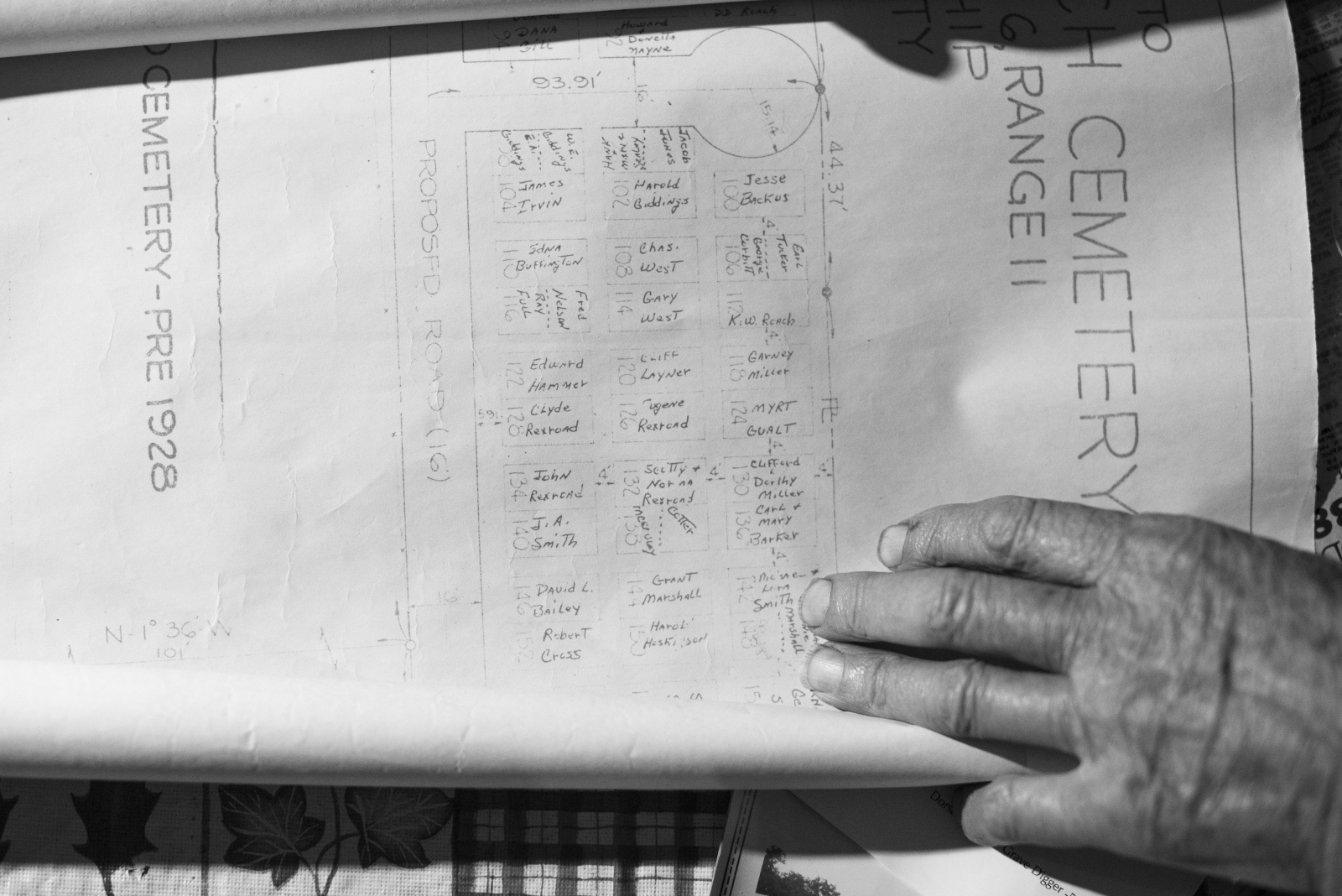 Dorsel Bibbee shows an old cemetery map from his collection at his home in Alfred, Ohio, in February 2015.