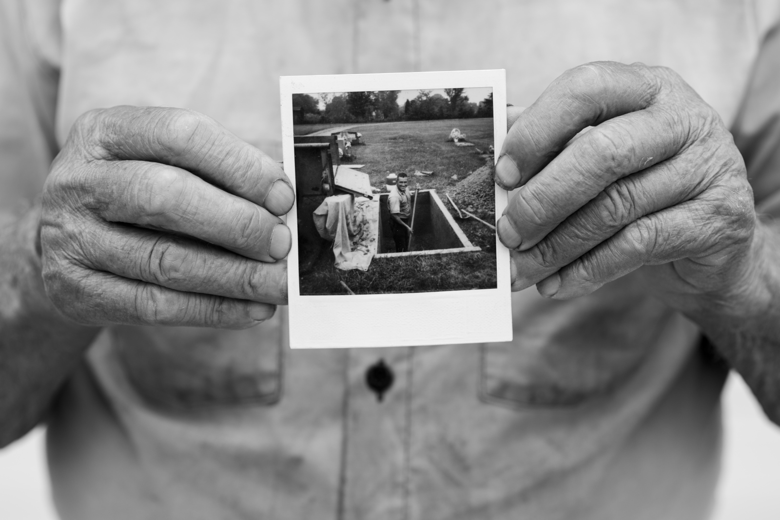 In June 2015, Dorsel Bibbee holds a photograph of himself as a younger man standing in a grave. Bibbee believes the photograph is from the late 1970s or early 80s, but he's no longer able to remember who took it and gave it to him. He has been digging graves in southeast Ohio for six decades.