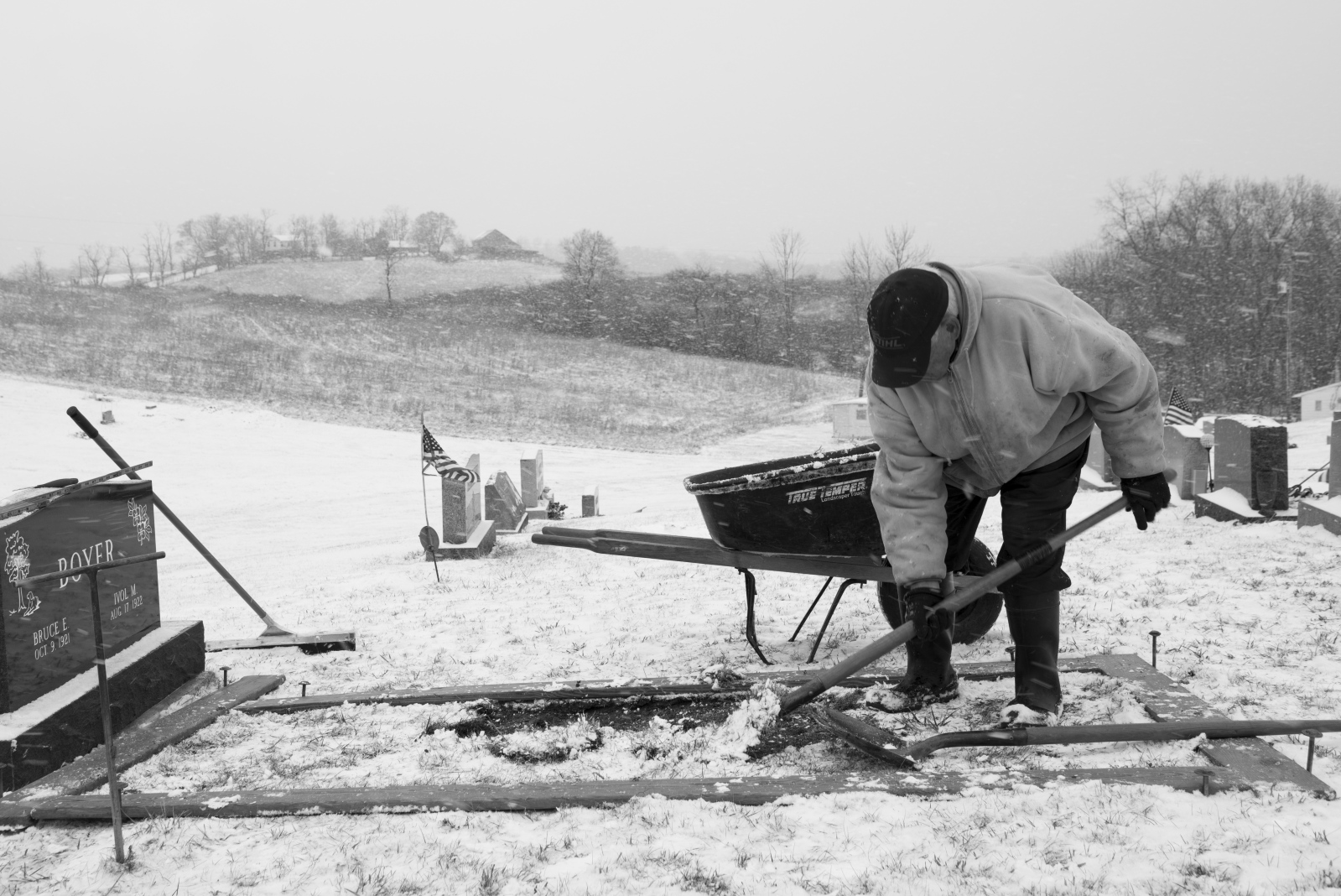 Dorsel Bibbee works through swirling wind and snow to prep a grave site at Coolville Cemetery in Coolville, Ohio, in February 2015.