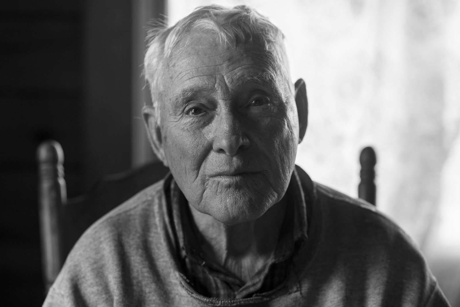 Dorsel Bibbee, 81, sits for a portrait at his home in Alfred, Ohio, in February 2015.