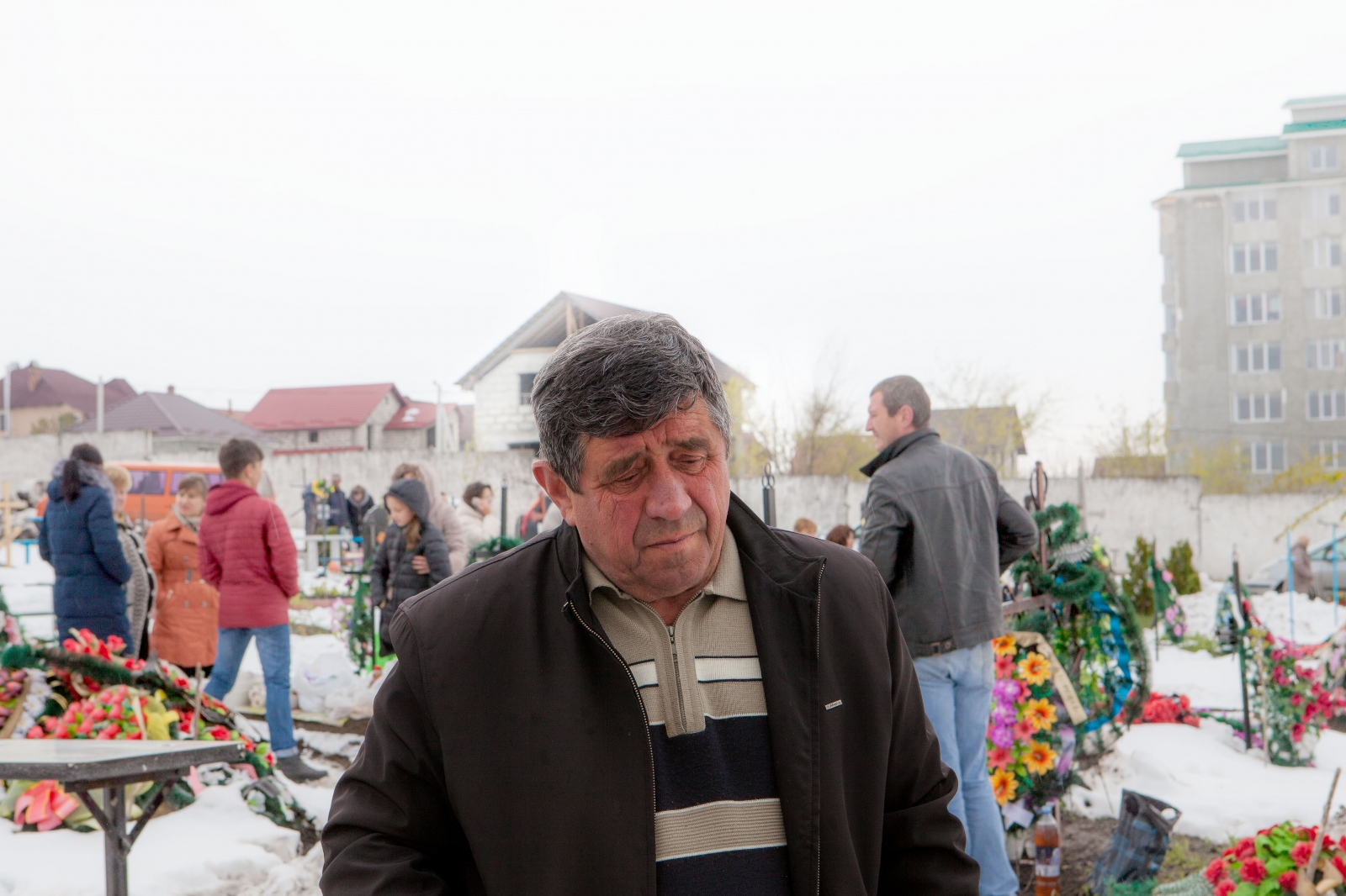 "In 2017, I spend Pastele Blajinilor with Ion. We slump through the snow and mud up to the cemetery. Just days earlier a freak late-April snowstorm hit Moldova. As Ion and I have talked about his past, Ion recalls how the deportations were a tragedy for his parents, but he was so young at the time that he still struggles to remember some parts. Ion is a quiet and warm, yet stoic man who speaks less of his deportation than Nina. The ways in which deportees remember their deportations differs significantly, some coming back to their experiences over and over again, and some thinking of them as a footnote in a young life. Today, Ion tends to focus more on the issues directly at hand, caring for his garden, making wine, and spending time with his family. Ion remembers, ""I was only a child [when we were deported], and the events didn't affect me much, don't feel attached to them. But my parents, they were the ones who pulled the laboring oar… You know, we couldn't talk [about the deportations] with our parents, we didn't want to ask them anything and they didn't want to tell. I guess they were very afraid when they were taken away and they must have suffered a great deal. They were forced to keep their mouths shut lest someone in power should find something out about them. My father had a saying, 'Don't play with the state, because you're playing with fire.'"""