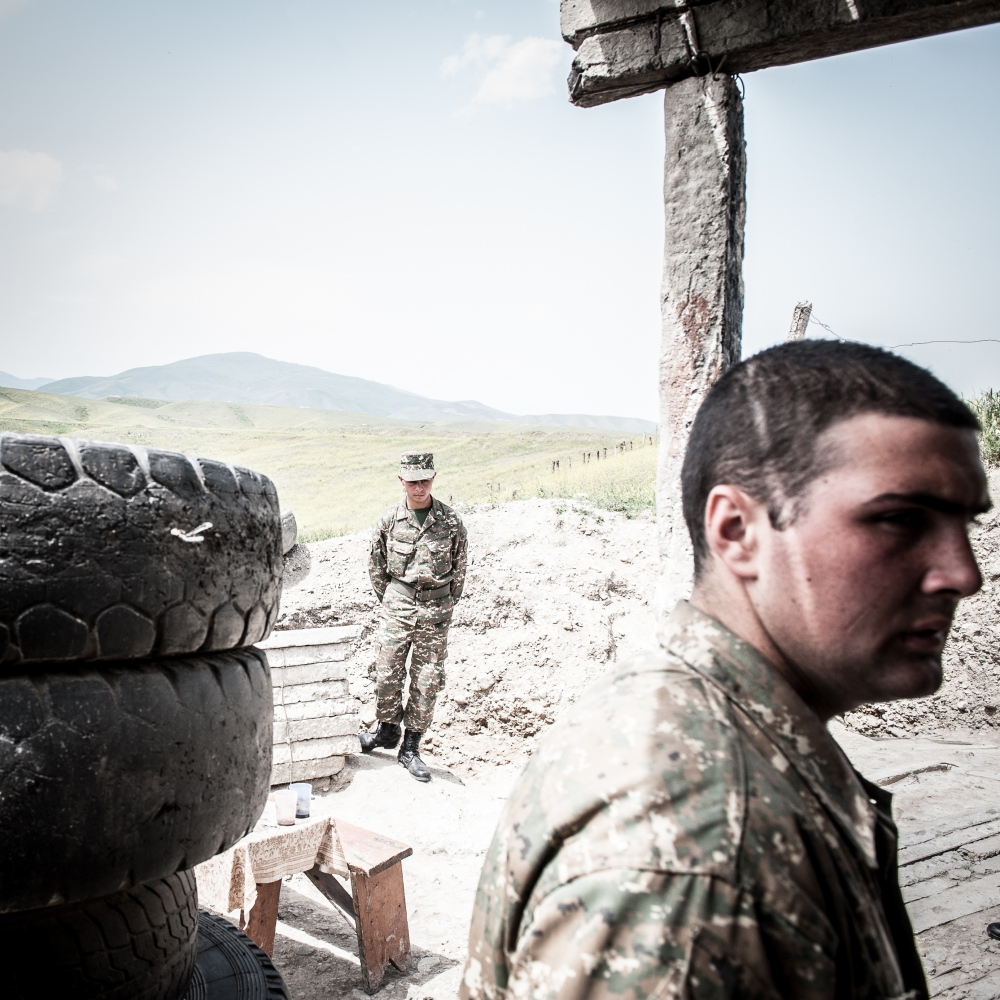 Two young soldiers engaged over the frontline in the Armenia-backed separatist region of eastern Nagorno-Karabakh Republic .