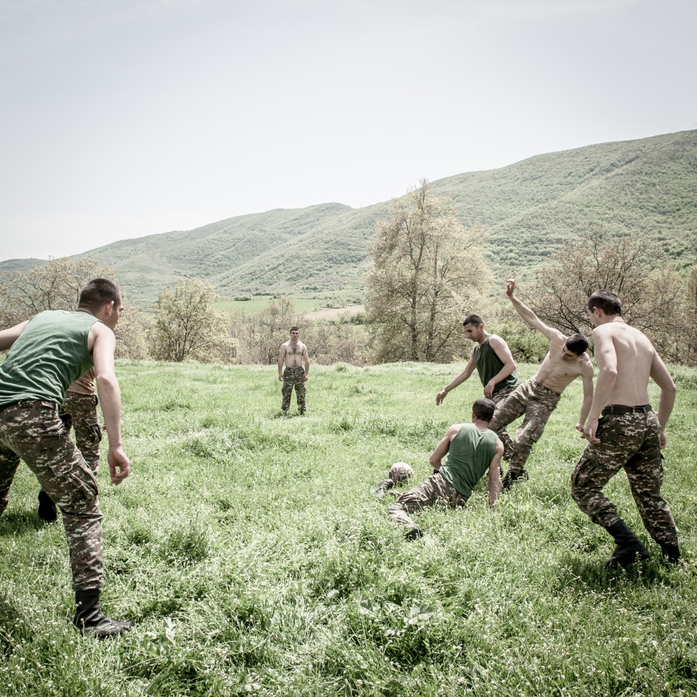 An extemporary football match between young soldiers in Hadrowt village, next to the Iranian border.
