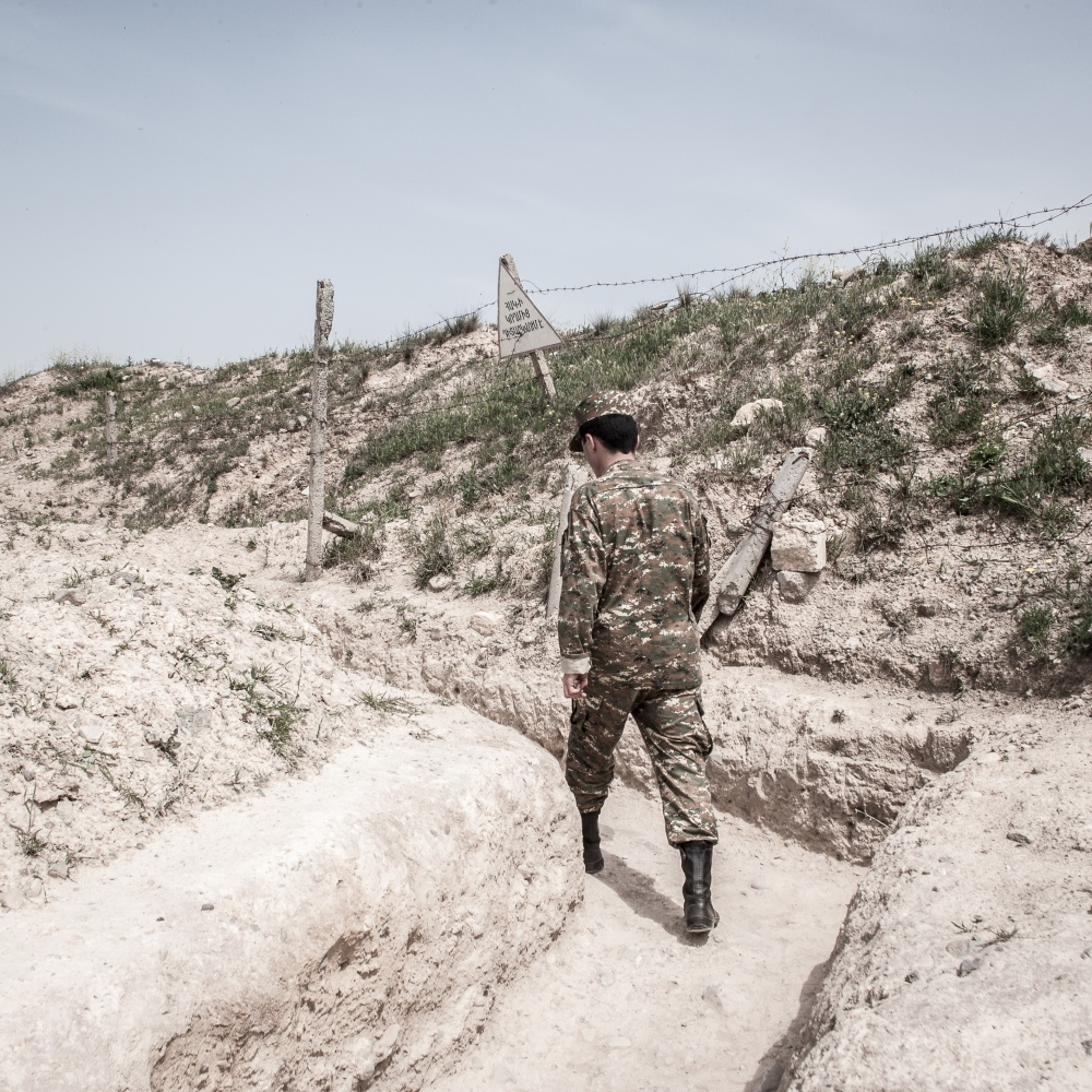 A soldier has a walk through the trenches at the frontline in the Armenia-backed separatist region of eastern Nagorno-Karabakh Republic .