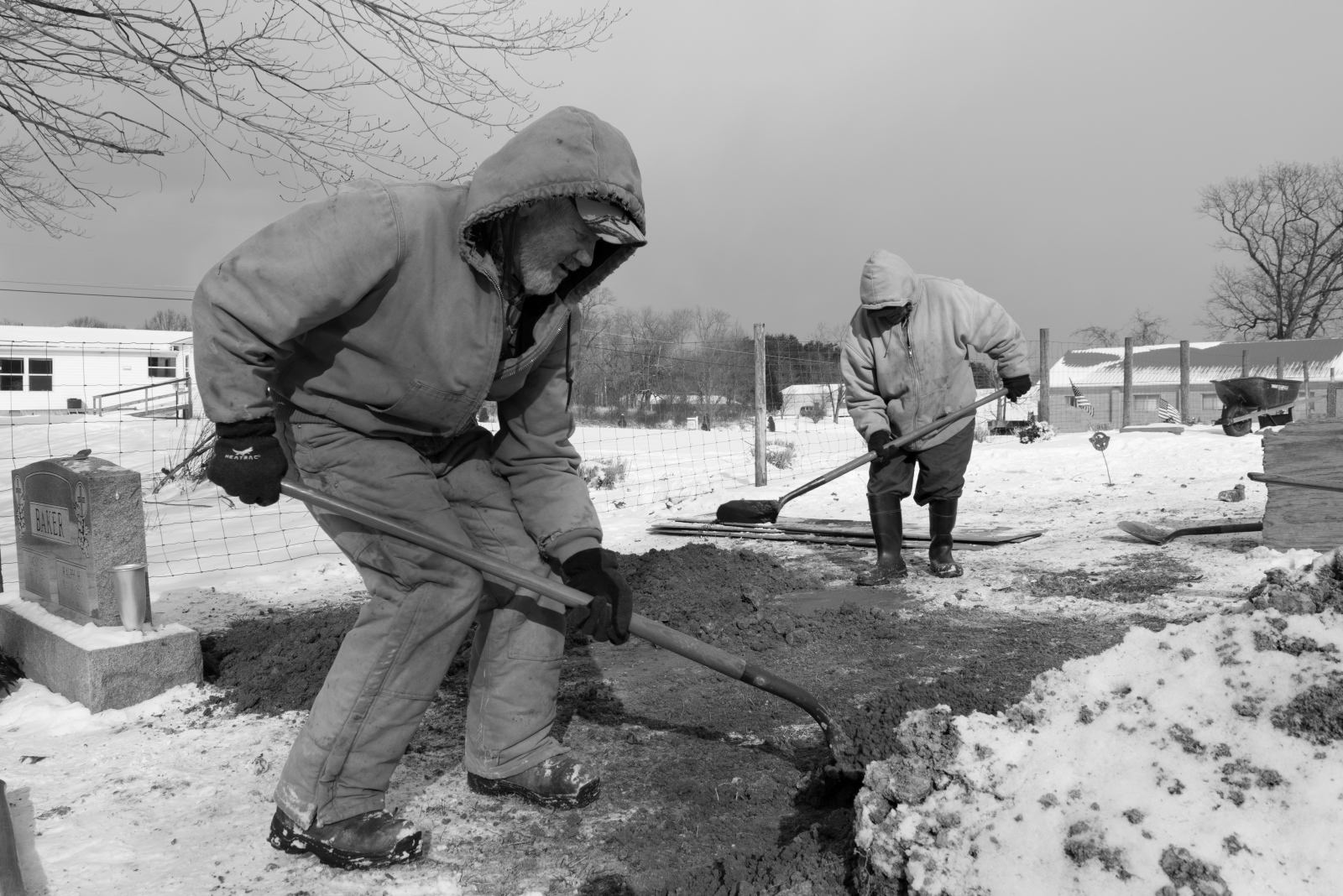 Jimmy Putman and Dorsel Bibbee dig a grave at Fairview Cemetery in southeast Ohio in February 2015.