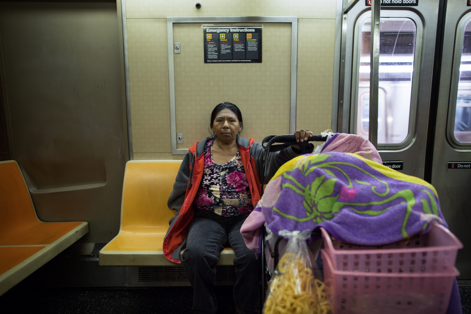 Dionisia on the subway, going to sell sweets on the streets, Sunset Park, Brooklyn, 2016.