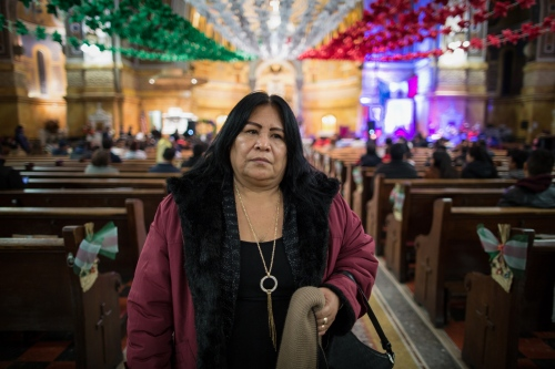 "Juanita is faithful devotee of the Virgin of Guadalupe, every December 12 goes to celebrate the mass in her honor into the Catholic Church of San Miguel in 42nd Street at her neighborhood. ""The virgin always accompanies me, she helped me to cross the border and take care of my daughter Maria when I was sick. That's why every year I celebrate her birthday and bring her flowers"" Juanita comet.  Sunset Park, Brooklyn, New York. 2016"