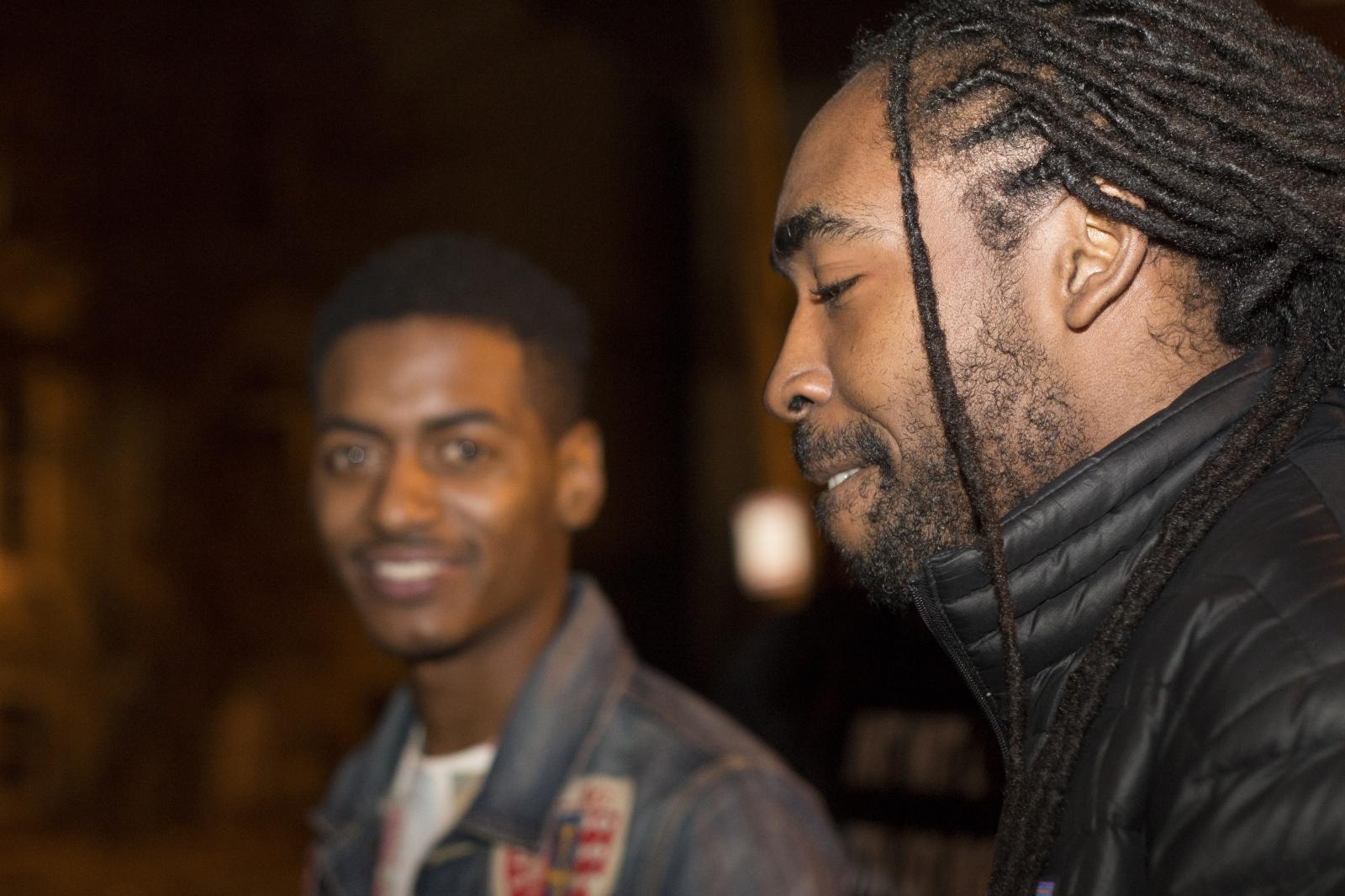 young black men standing