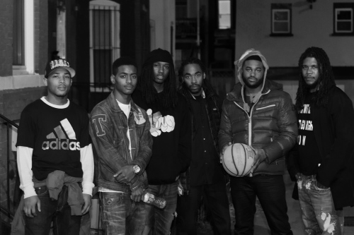 a group of black men standing outside