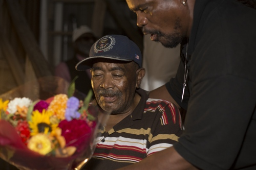 a man receiving flowers for his birthday