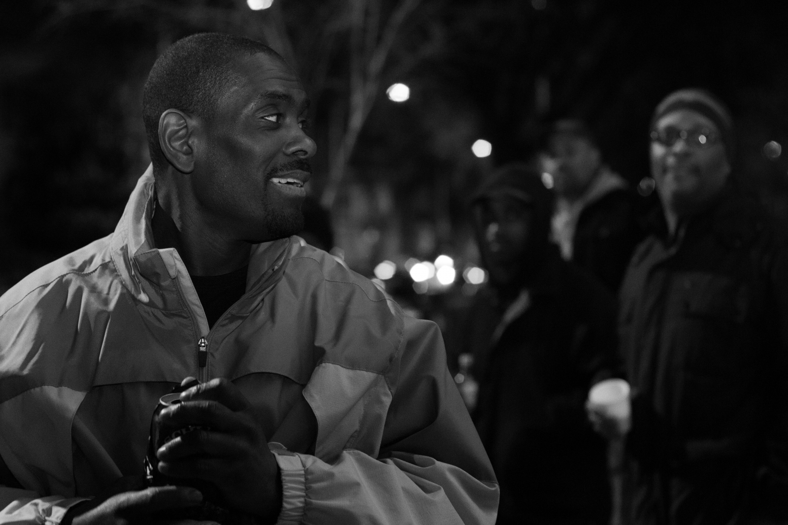 a group of black men talking outside
