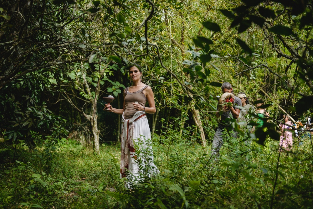 Smudging the path with 'copalera' in hand, Catalina leads the procession of visionaries through the jungle to their allocated places of power where they will be praying, meditating, and fasting for four days.