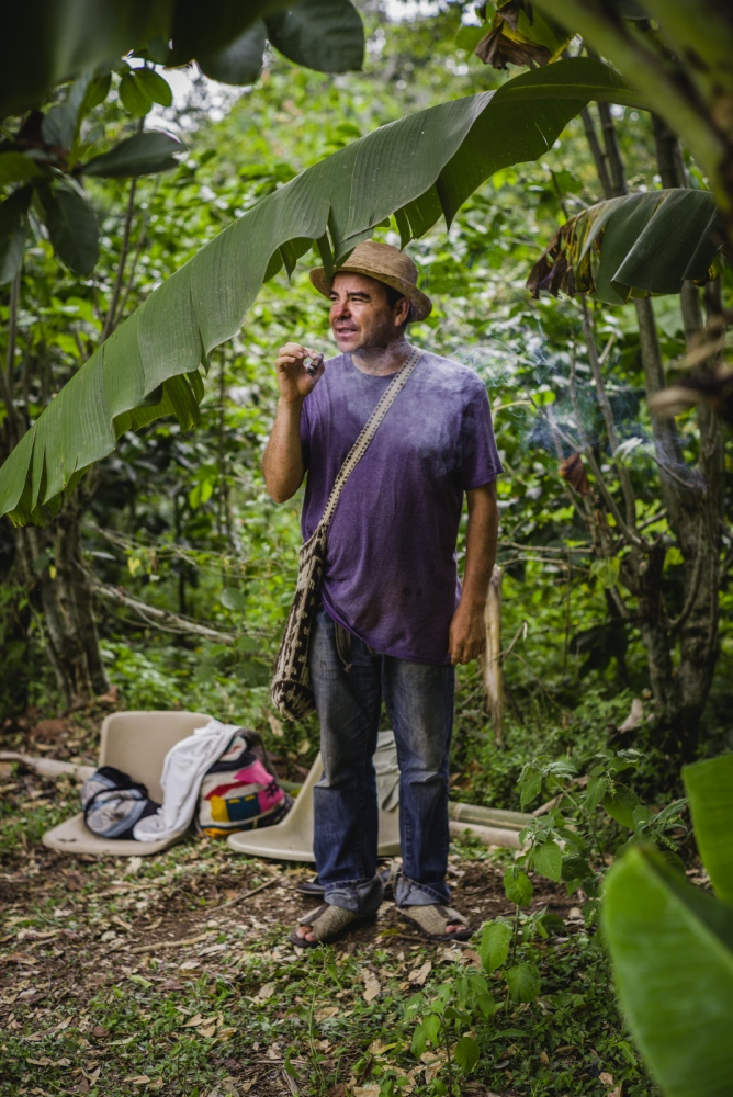 Tomás, a traditional medicine man, originally from Mexico, smoking a cigar in a sacred way to pray for the visionaries and for the wellbeing of all attendees during the Vision Quest.