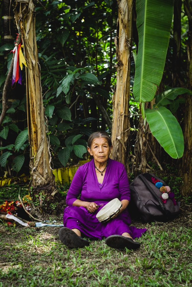 Abuela Ana Lucia of the indigenous Embera people of Colombia, playing her small drum after having quested for 4 days during the Vision Quest.