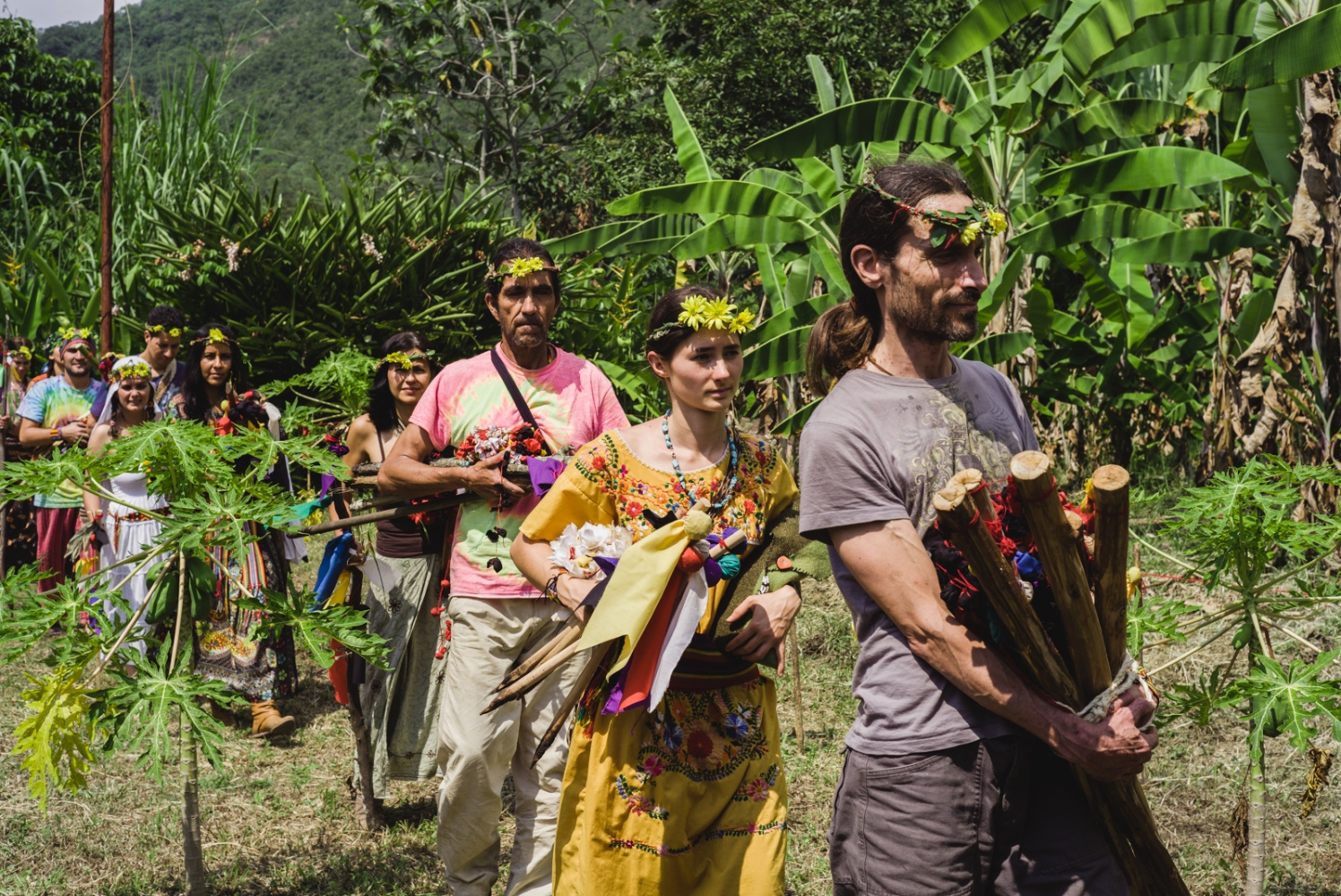The visionaries return from questing and fasting 4 days in the mountain, bringing their prayer staffs and offerings to be burned to the fire.