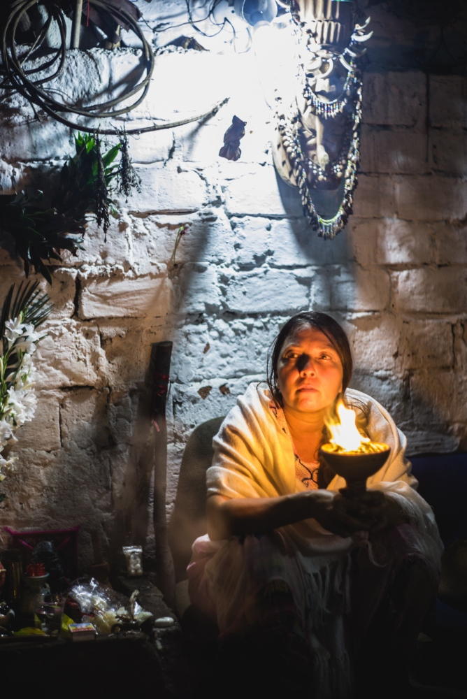 Citlali, 'yagecera' and traditional medicine woman, smudges her home with a 'copalera' to purify the energy of the space.