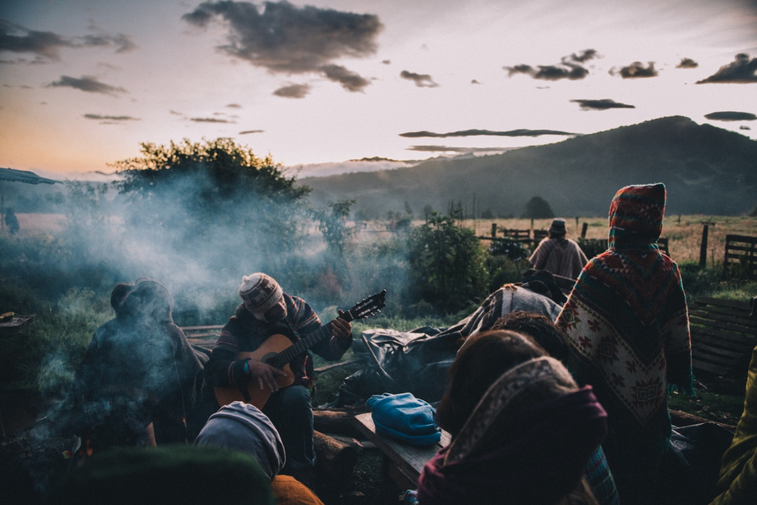 Travelers and festival goers emerge from the maloca to greet the rising sun after a nightlong ceremony of Cacao and Ambira in La Calera, Colombia.