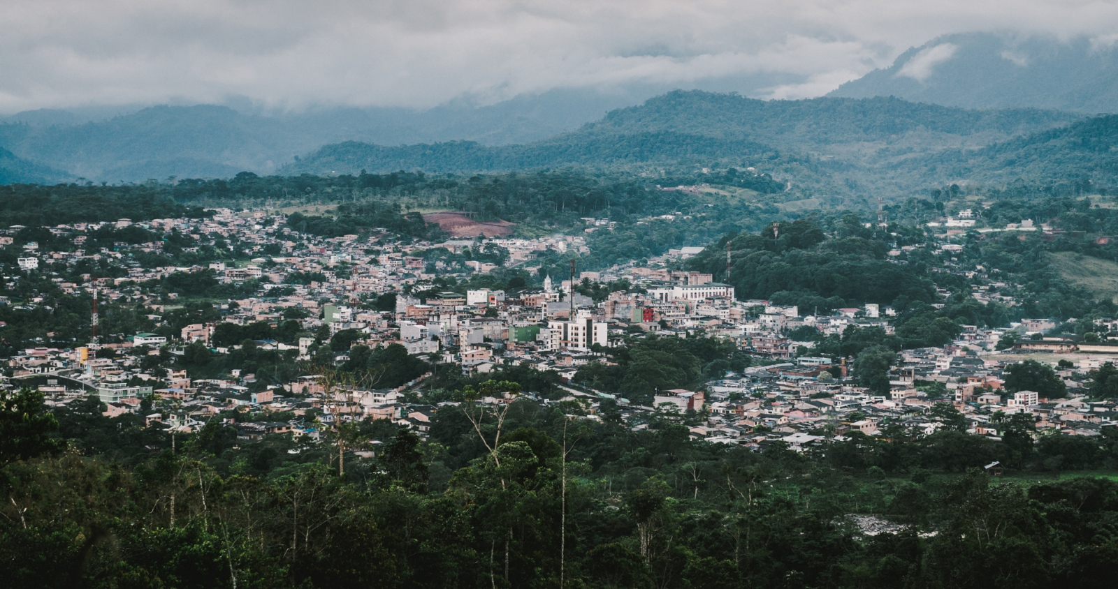 The city of Mocoa, Putumayo, Colombia, seen from the jungle across the river.