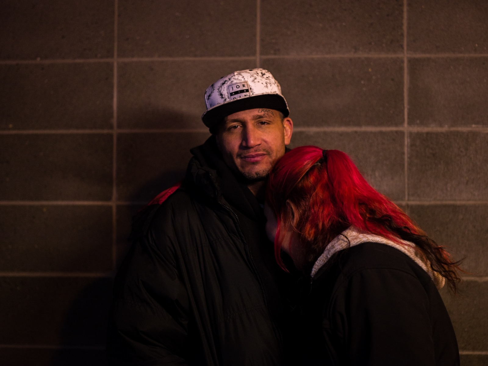 Michael Charles, 39, and Gabriella Tinker, 23, stand together outside of Brother Francis Shelter. Tinker has been homeless since she was a teenager. Charles came up to Alaska from California recently to work in commercial fishing, and stayed after the season ended. Charles says he is now looking for work. The couple say they were married a few months ago but have never had a photograph made of them together. (For the Guardian.)