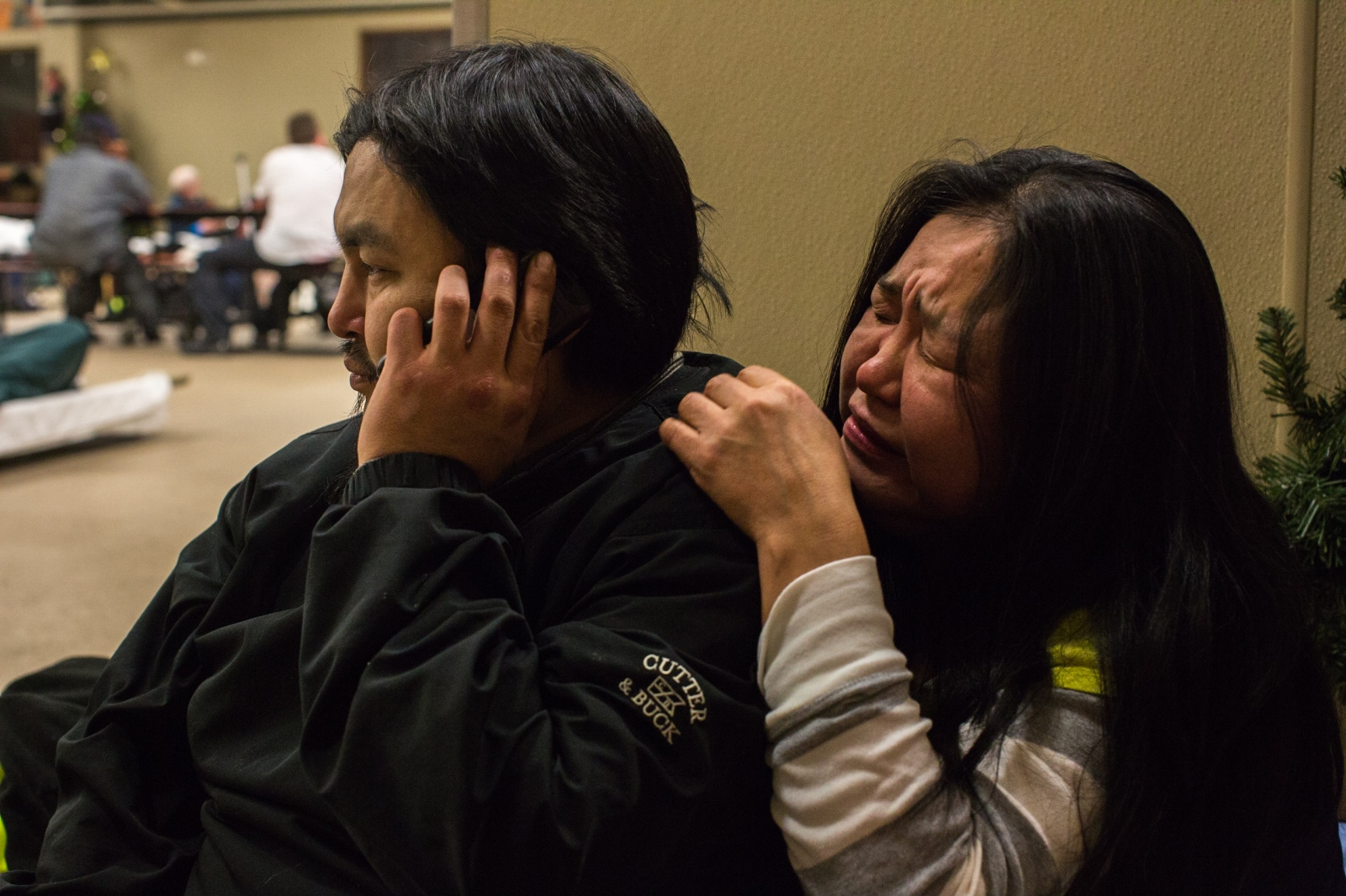 "Marie Nickolai sobs while her husband, Steven Moses tells Nickolai's other brother that their half-brother died earlier that day. "" I just couldn't call him,"" she says."