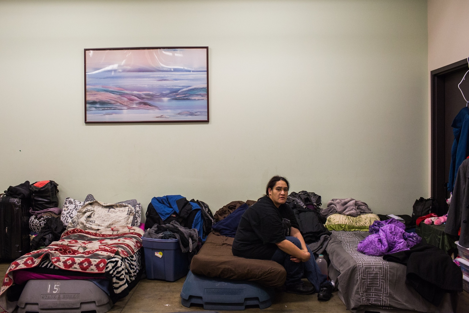 Shara Summers, 32, sits on her bed in the women's dormitory in Brother Francis Shelter in Anchorage. Summers says she has been homeless for most of her life.