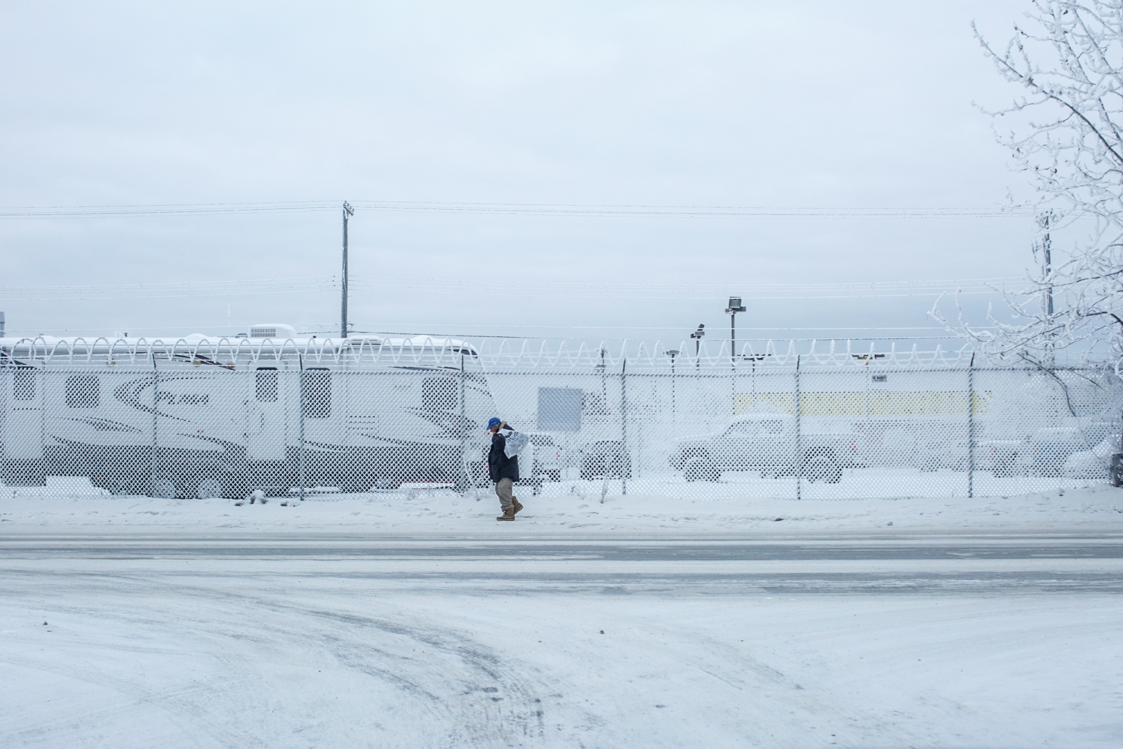 A man walks towards Bean's Cafe and Brother Francis Shelter in Anchorage, Alaska. The city has experienced temperatures in single digits for the past week.