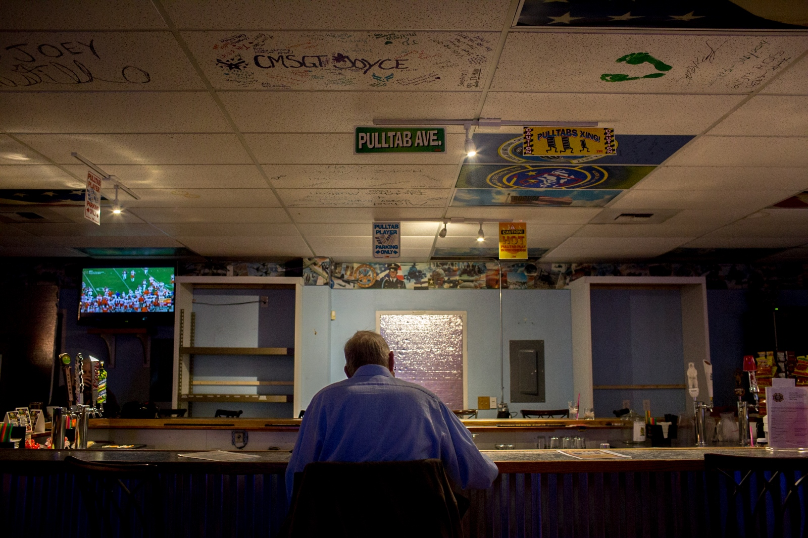 Joe Federmann, 71, sits at the bar at VFW Post 9981 on football night. Federmann moved with his family to Alaska after he returned from serving in the Vietnam war. He says that there are a lot of reasons he's stayed in Alaska; he finds being in nature peaceful and loves the fishing and large community of veterans.