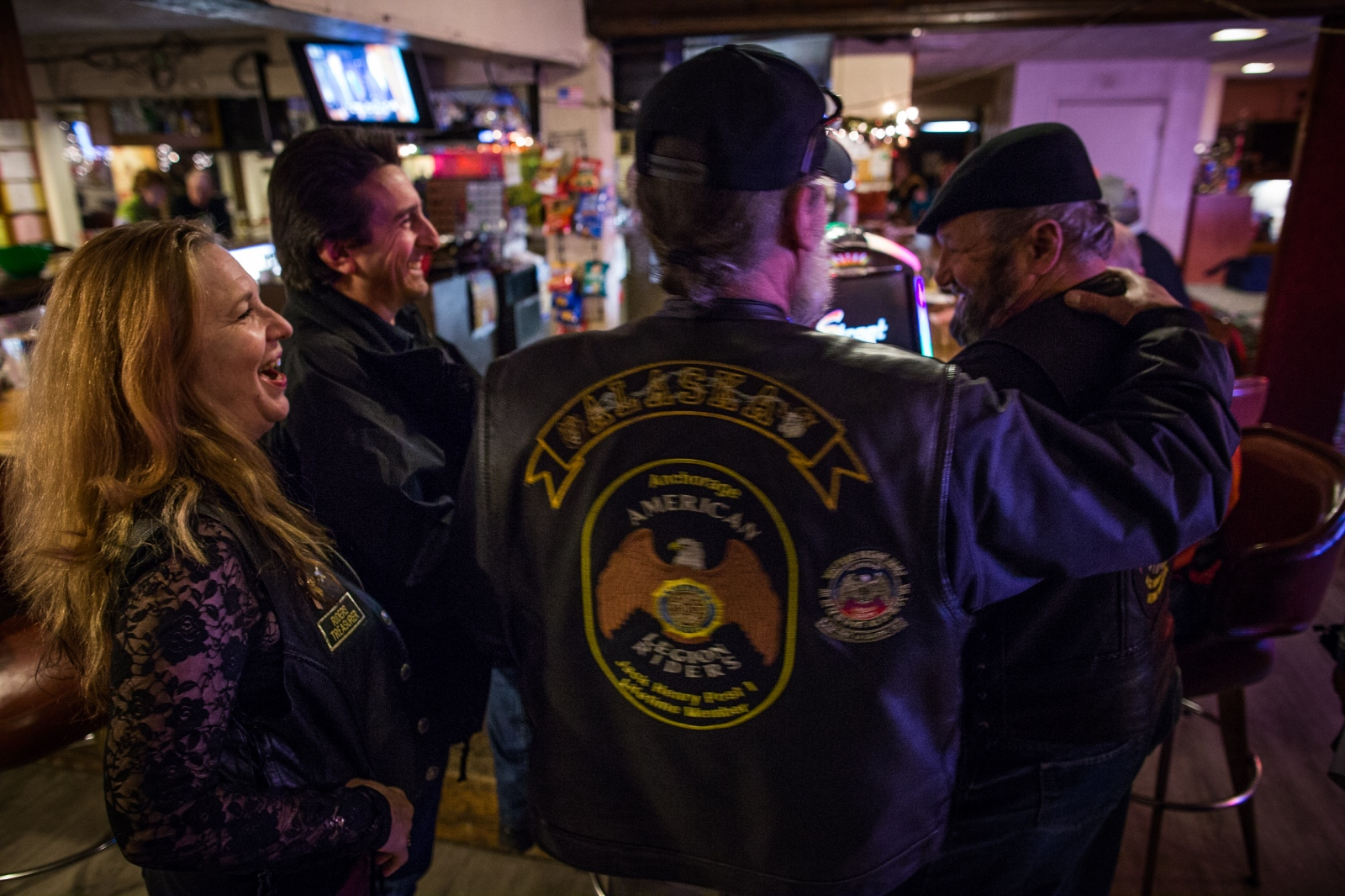 "Members of the American Legion Riders (from left to right: Mark Berg, Tylor Wilson, Richard Crook, Charlie Brown, and Woody Quackenbush) hang out at the American Legion Jack Henry Post 1 in Anchorage, Alaska. ""We're like a family,"" Berg, who is also the state director of the American Legion Riders, says. ""This is a place you can go where no one will ask you how many people you shot."""