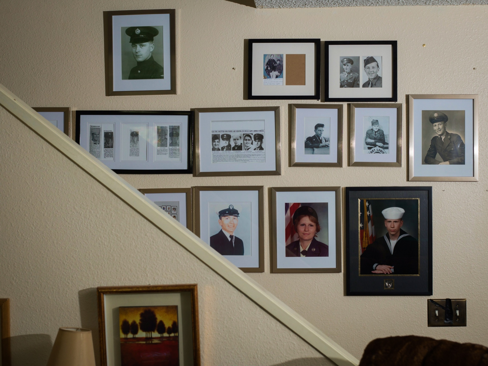 "A wall in Tina Cramer Showers' home in Anchorage, Alaska. Showers comes from a family of veterans; she counts 27 members of her family have served, but she suspects that there are more. ""I have more to add up here,"" she says."