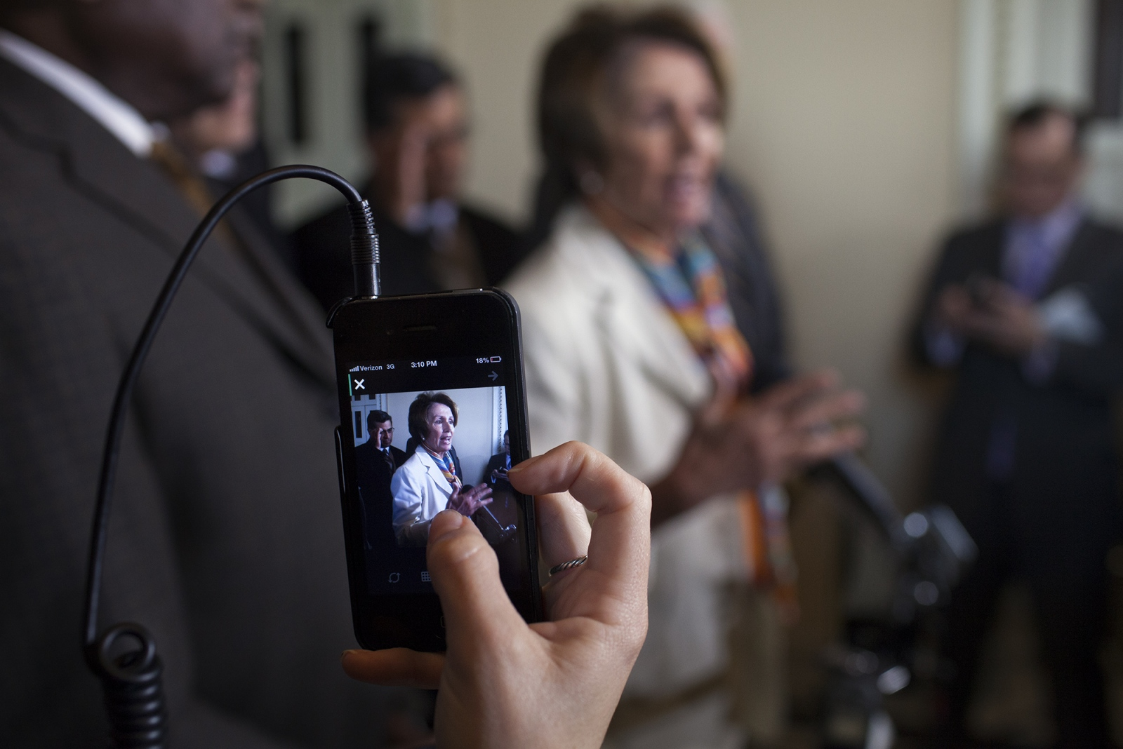 Represtative Nancy Pelosi talks with reporters in the U.S. Capitol.