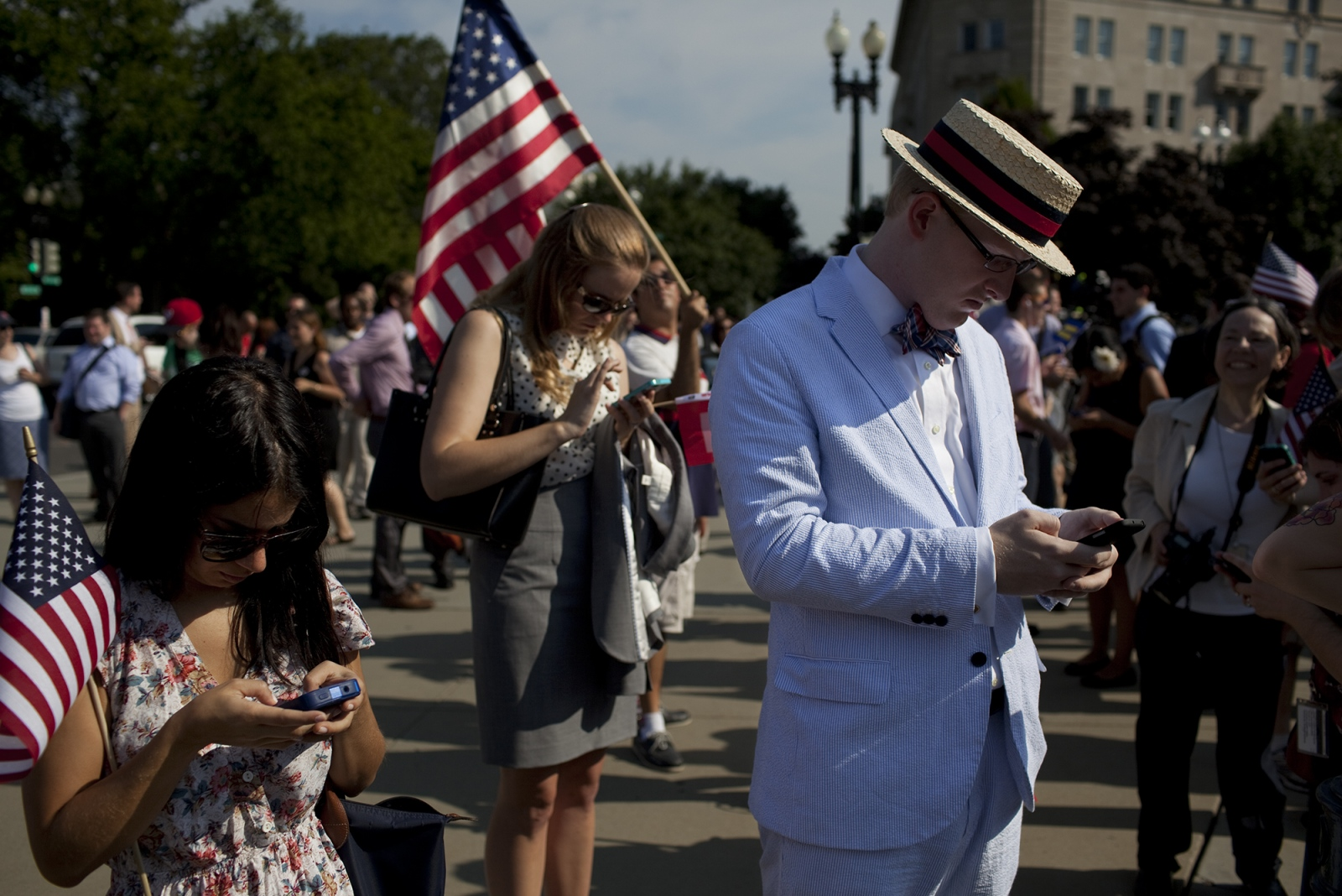 Checking tweets outside the Supreme Court.