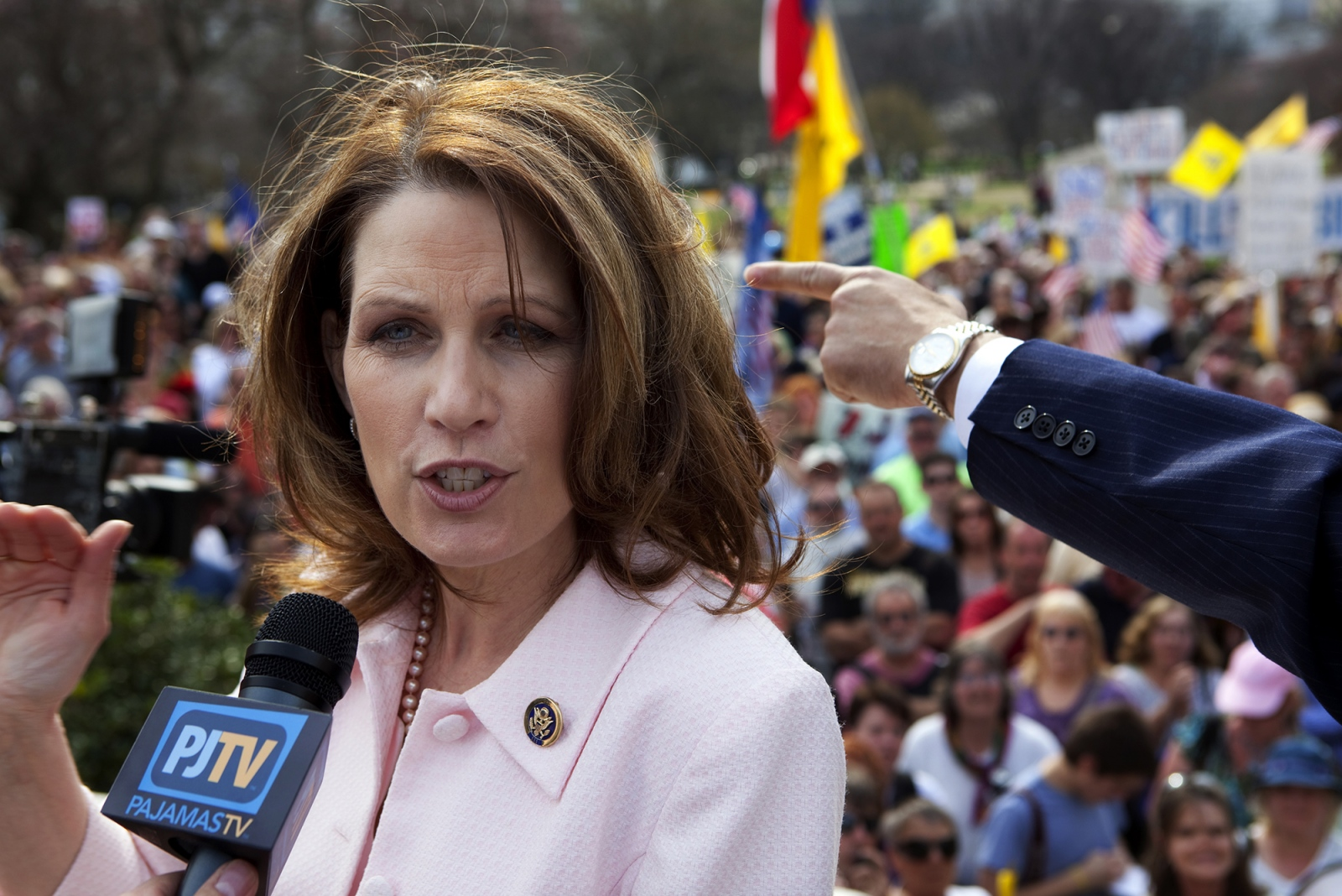 Then-RepresentativeMichelle Bachman being interviewed outside the Capitol building.