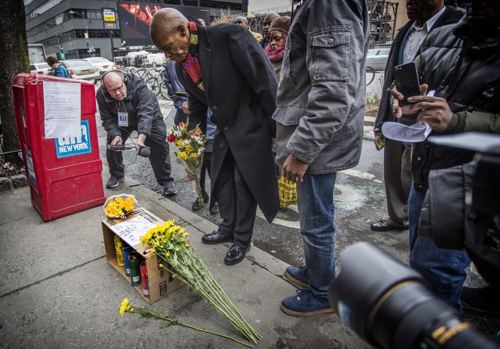 Photography image - Brooklyn Borough President Eric Adams at a Manhattan memorial to Timothy Caughman,age 66, who was fatally stabbed on March 22, 2017, by James Jackson, a white supremacist who travelled from Baltimore to New York to kill black-men. (Kevin C Downs/Agence Cosmos/ for the NY Daily News)
