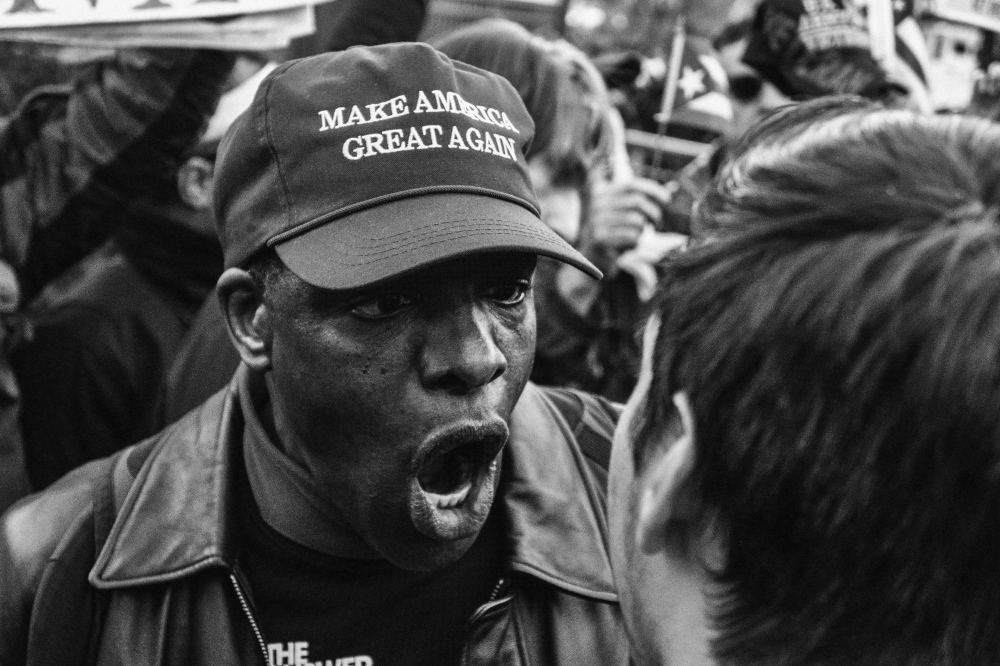 """Photography image -  (Welcome to Trumpland) A small group of Trump supporters tried to disrupt a peaceful protest held by anti-Trump """"Not my president"""" protesters outside of the Trump International hotel. New York, February 20,2017 (Kevin C. Downs/Agence Cosmos)"""