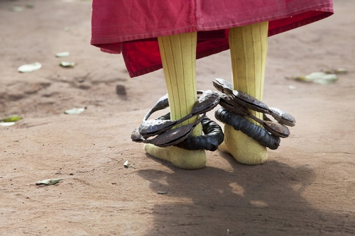 During the Guelede dances, meant to worship 'the mothers', feminine spirits, but only men and boys dance, wearing costumes, masks, and small bells at the ankles. Ofia, Benin, 2017. ©Laeïla Adjovi
