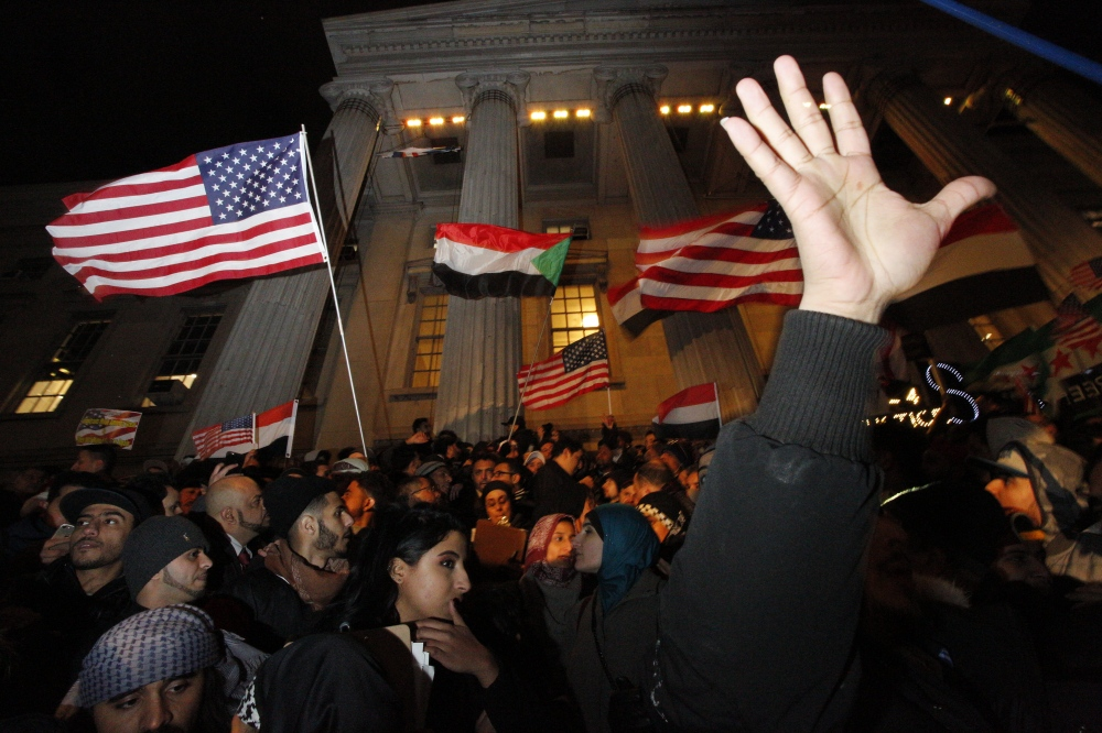 Photography image - Thousands of Yemeni bodega owners and other Arab American groups protested Trump's Muslim travel ban at Brooklyn's Borough Hall on February 2, 2017.(Kevin C Downs/Agence Cosmos)