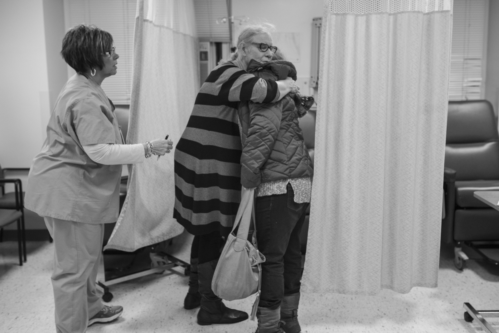 Moments before Jennifer is admitted to the pre-operating room she hugs Michelle goodbye at the Hahnemann University Hospital in Philadelphia, Jan. 11, 2017.