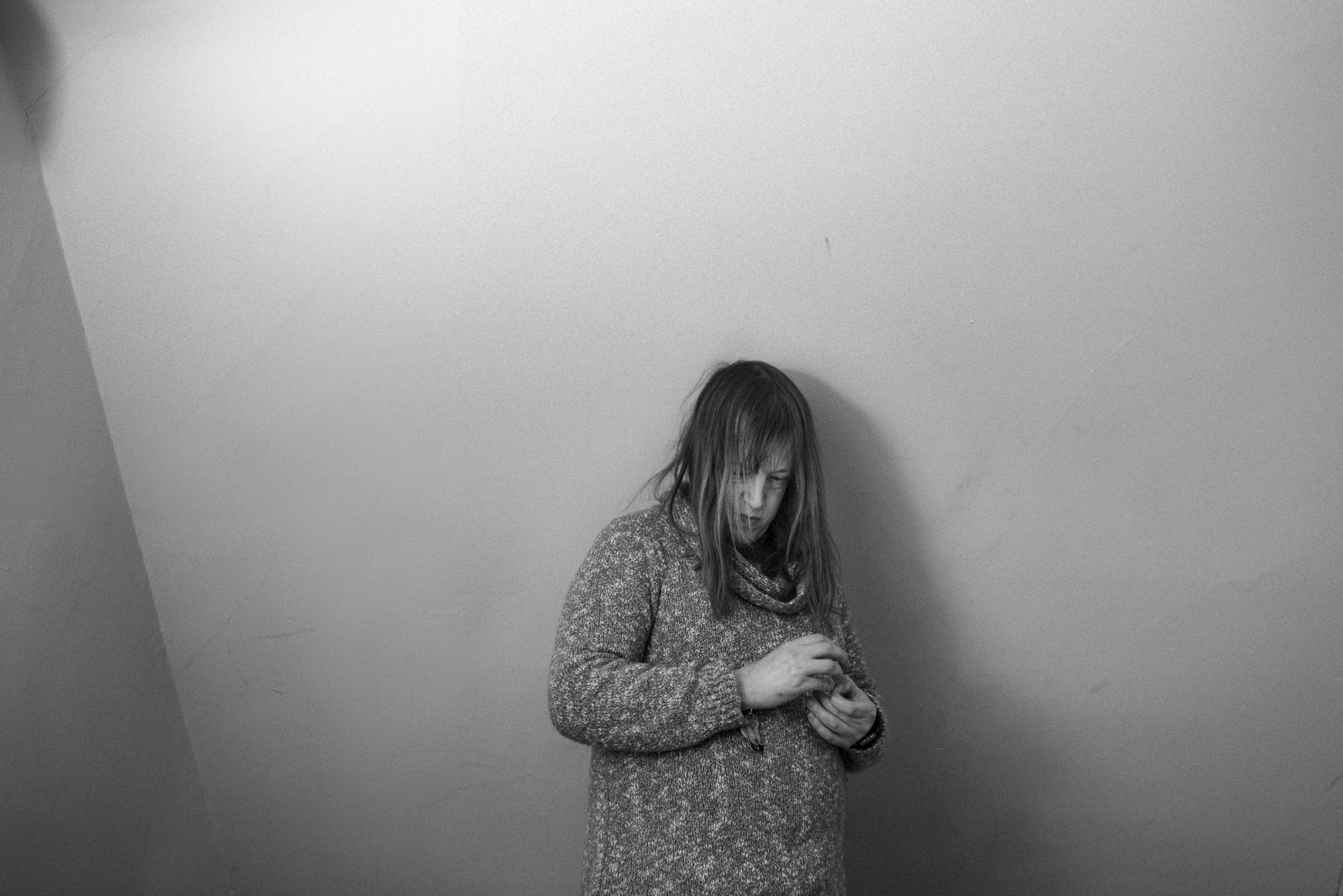 Michelle pauses by the bedroom wall in Philadelphia the night before Jennifer's operation in East Philadelphia, Jan. 10, 2017. Michelle worries she won't be able to support and comfort Jennifer enough after her operation.