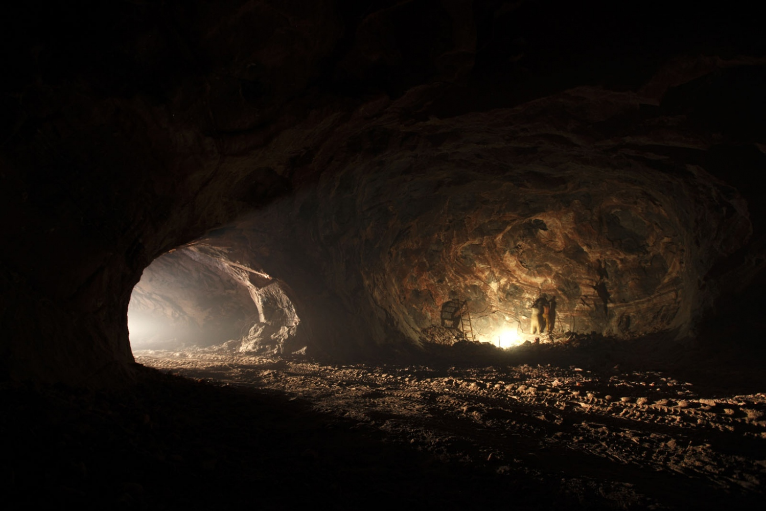 The pitch black mine shafts of the Warcha salt mine, only illuminated by gas lamps or the occasional passing truck. Everything inside the mine from floor to ceiling is made of salt. Punjab, Pakistan.