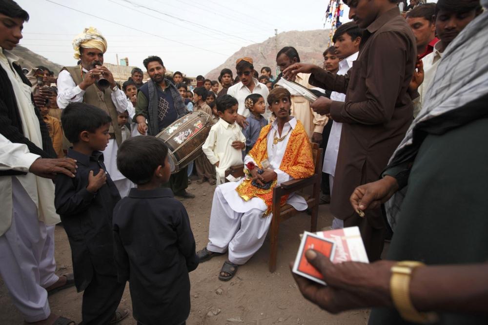 A wedding celebration is held for a salt worker inside the grounds of the Warcha salt mine. Punjab, Pakistan.