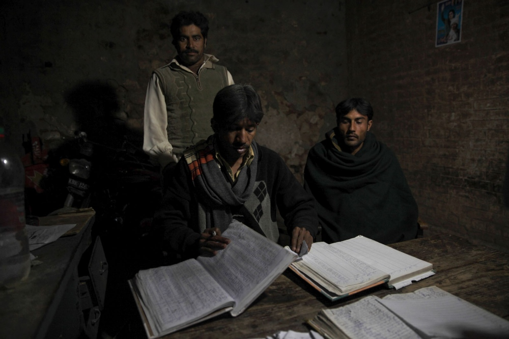 At the Warcha mine every truck containing salt is documented as it leaves the mine in large account books. The entire accounting system of all the mines remain hand-written. Punjab, Pakistan.