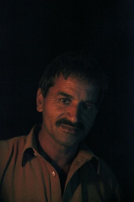 A salt workers in the darkness of the Kalabargh salt mine. Punjab, Pakistan.