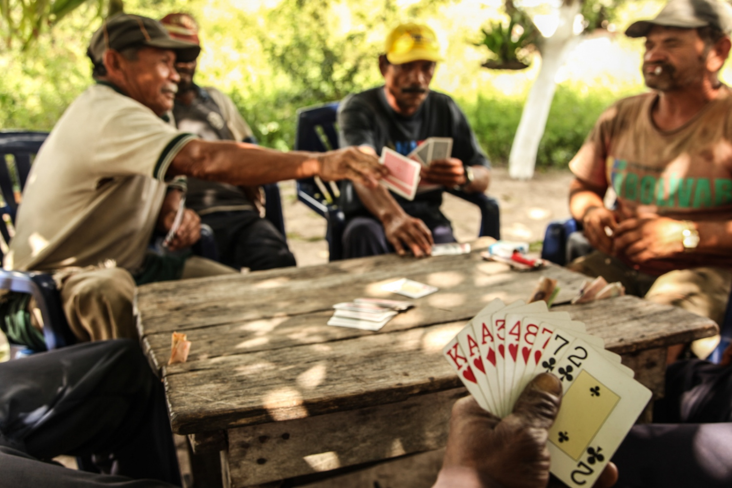 When they are not working, the miners join together to play cards, and to talk about the places where they think they can find gold.