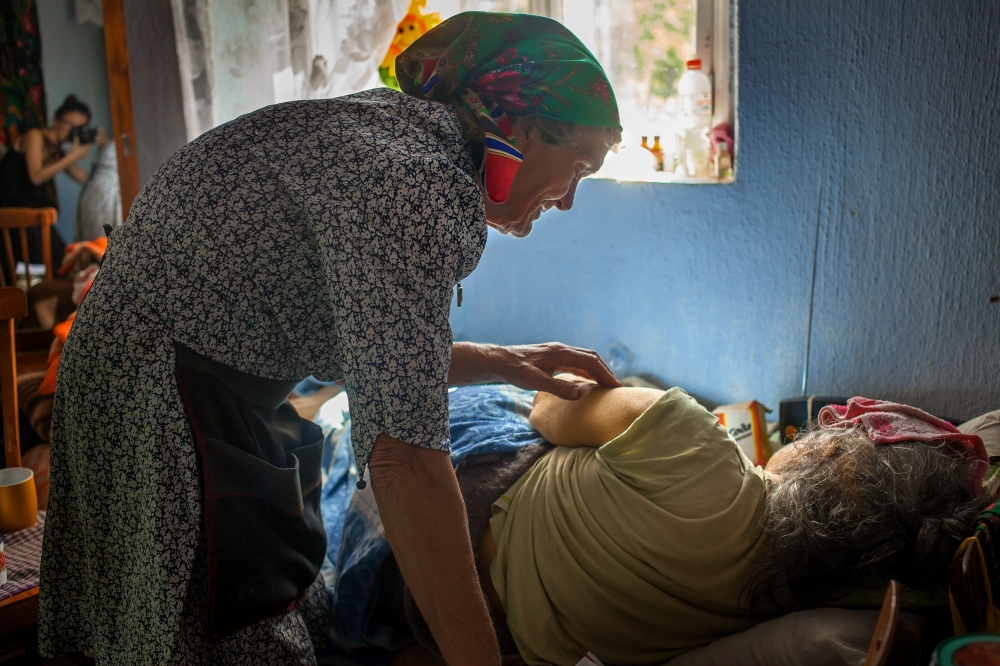 Photography image - Pasha is reaching the end of her life and the entire family is trying to figure out how to understand her last days. Here is has a high fever and her sister Ana is trying to care for her, however, after years of living together and the difficulty that comes with that, Pasha is little desirous of her sister's help.