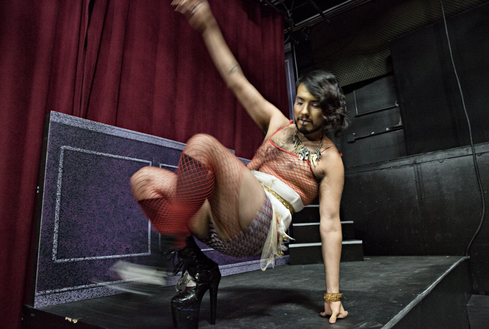 A member of Vaudzilla Burlesque practices his routine before the show begins.