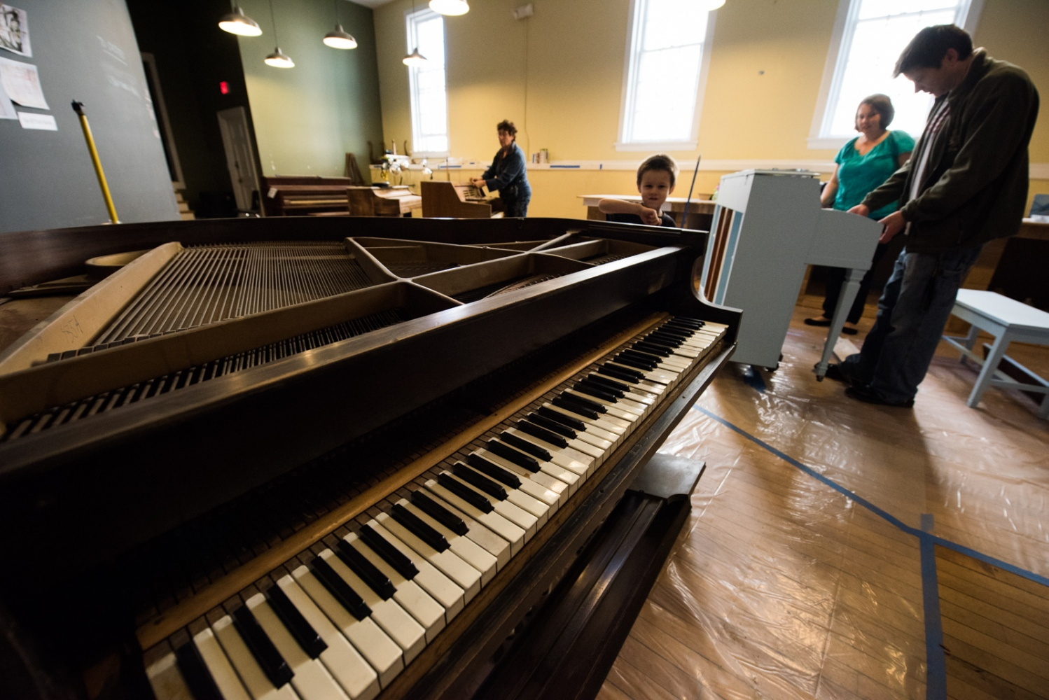 All the work is completed at Piano Central which is a space donated by a local business for the duration of the project. The pianos are washed to remove dirt, dust and years of accumulated grime, then sanded.