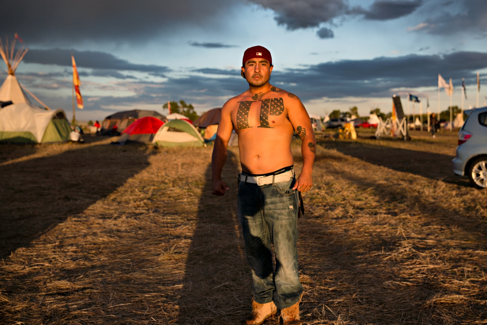 September 8, 2016- Cannon Ball, North Dakota, United States:Red Bear from Santa Rosa, CA came to support the NoDAPL movement along with his cousins. His tattoo of Indian Power took more than two days to finish.