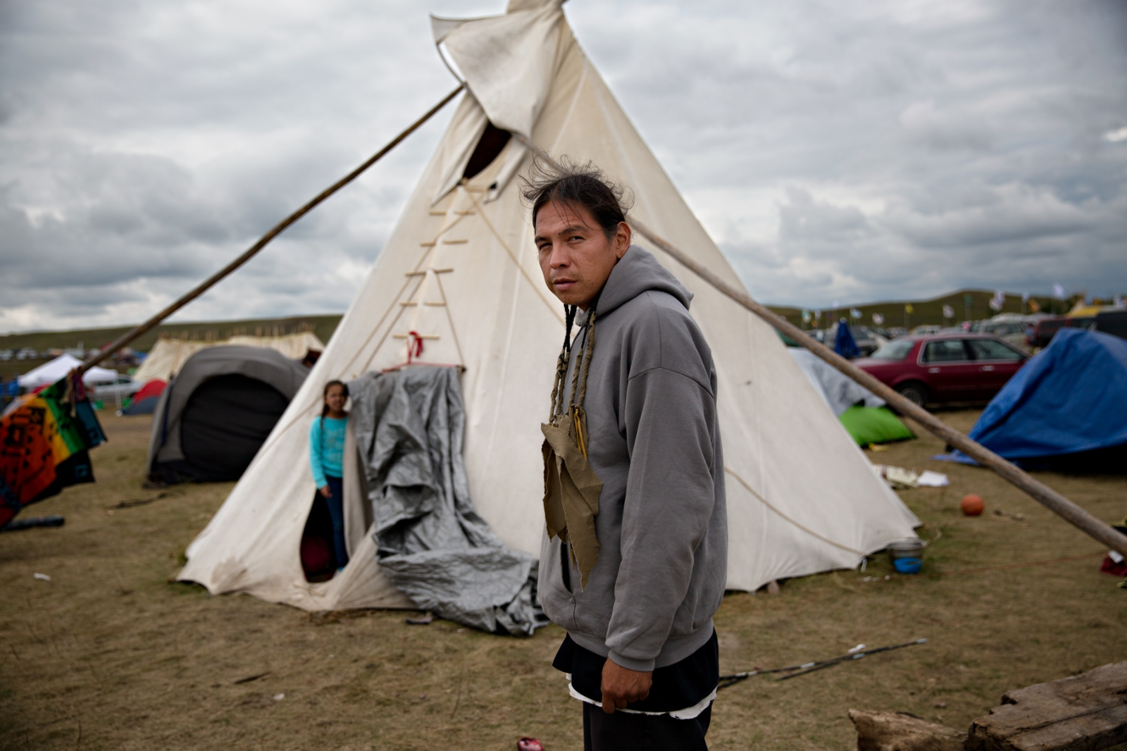 September 9, 2016- Cannon Ball, North Dakota, United States:John Swiftbird from Pine Ridge Reservation in South Dakota and his daughter stand in front of their tippie-he will remain at the Oceti Sakowin Camp until the work on the pipeline is stopped forever.