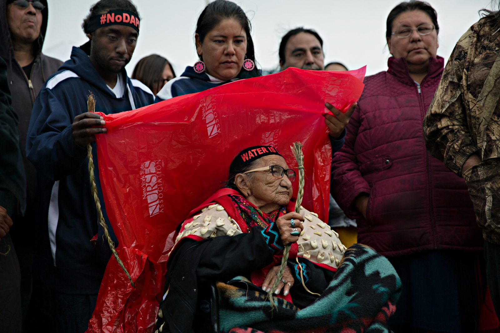 An 86 year old elder from the Sioux Tribe came to the gathering on her wheelchair after the Court denied the tribe's requested temporary restraining order against the Dakota Access Pipeline. While the Court ruled against the tribe's motion to halt the pipeline progress, the Obama Administration declared that it would stop construction until further consultation with the tribe--and action that appears to have been motivated by the intensity of the protests and the popular support they had generated.
